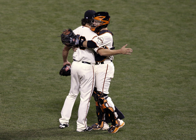 San Francisco Giants catcher Buster Posey hugs pitcher Madison Bumgarner after defeating the Kansas City Royals 5-0 in Game 5 of baseball's World Series Sunday, Oct. 26, 2014, in San Francisco. Th ...