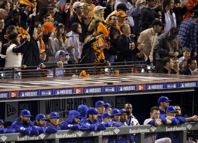 Fans cheer over the Kansas City Royals dugout during the ninth inning of Game 5 of baseball's World Series against the San Francisco Giants on Sunday, Oct. 26, 2014, in San Francisco. The Giants b ...