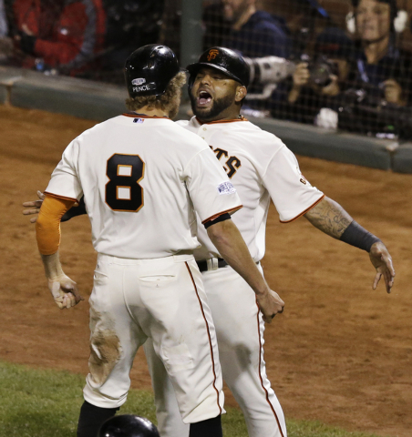San Francisco Giants Pablo Sandoval celebrates with Hunter Pence (8) after the two players scored on a two-run RBI double by Juan Perez during the eighth inning of Game 5 of baseball's World Serie ...