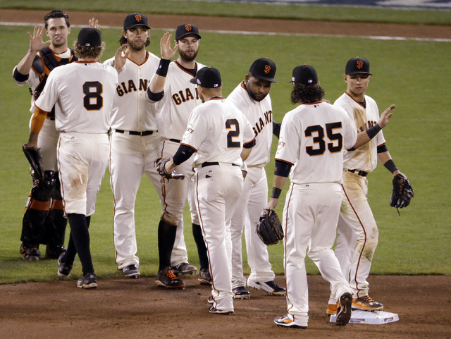 The San Francisco Giants celebrate after Game 5 of baseball's World Series against the Kansas City Royals on Sunday, Oct. 26, 2014, in San Francisco. The Giants beat the Royals 5-0 to lead the ser ...