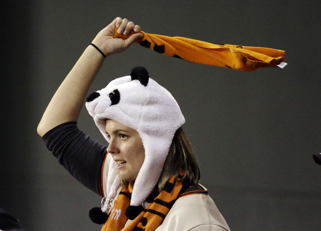 A fan cheers during the ninth inning of Game 5 of baseball's World Series between the Kansas City Royals and the San Francisco Giants on Sunday, Oct. 26, 2014, in San Francisco. The Giants beat th ...