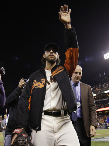 San Francisco Giants pitcher Madison Bumgarner waves to spectators after defeating the Kansas City Royals 5-0 in Game 5 of baseball's World Series Sunday, Oct. 26, 2014, in San Francisco. The Gian ...