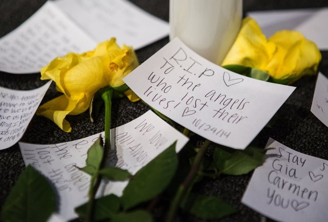Messages of support on the stage near candles and flowers in between morning services at The Grove Church in Marysville, Wash., two days after the Marysville-Pilchuck High School shooting, on Sund ...