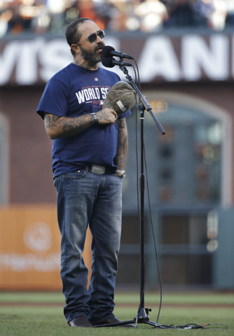 Recording artist Aaron Lewis performs the national anthem before Game 5 of baseball's World Series between the Kansas City Royals and the San Francisco Giants Sunday, Oct. 26, 2014, in San Francis ...