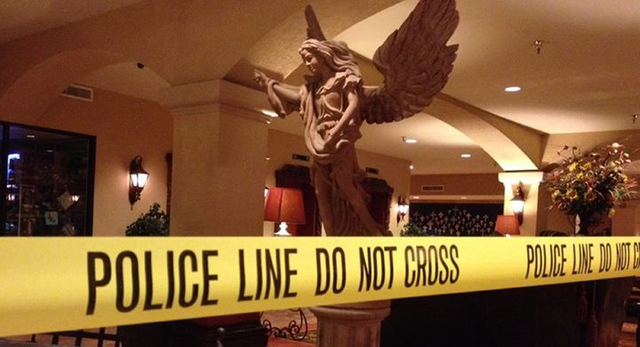 A area of the Hotel Encanto in Las Cruces, New Mexico, is closed off after a shooting Tuesday, Oct. 28, 2014.  Authorities say a Santa Fe County deputy has shot and killed a fellow deputy at the h ...