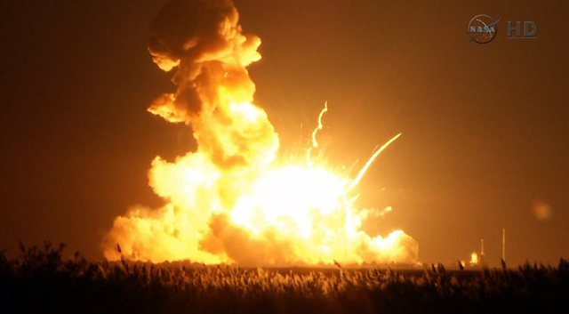 This image taken from video provided by NASA TV shows Orbital Sciences Corp.'s unmanned rocket blowing up over the launch complex at Wallops Island, Va., just six seconds after liftoff. The compan ...