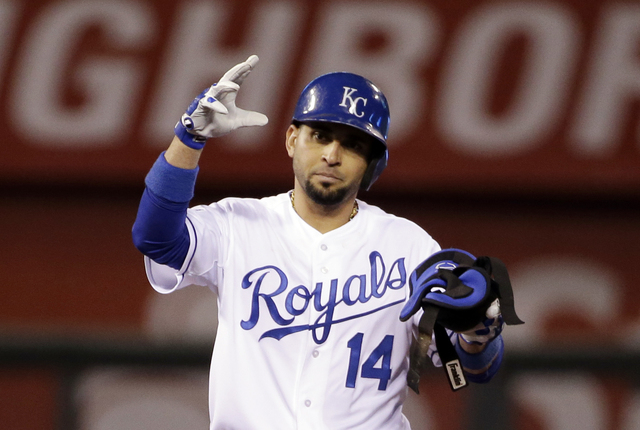 Kansas City Royals' Omar Infante reacts after hitting a double during the third inning of Game 6 of baseball's World Series against the San Francisco Giants Tuesday, Oct. 28, 2014, in Kansas City, ...