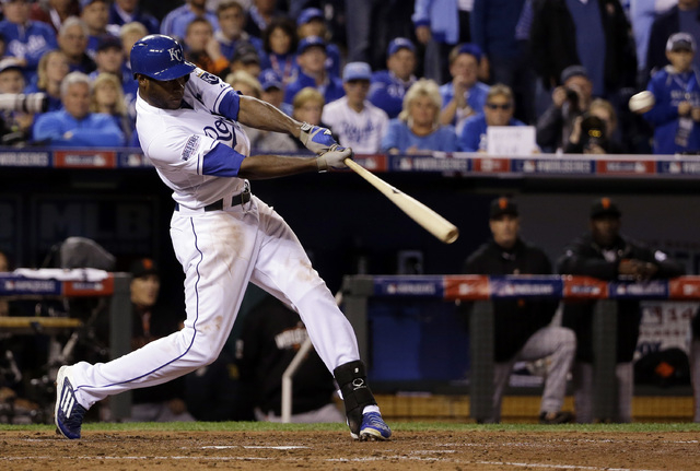 Kansas City Royals' Lorenzo Cain hits a RBI double during the third inning of Game 6 of baseball's World Series against the San Francisco Giants Tuesday, Oct. 28, 2014, in Kansas City, Mo. (AP Pho ...