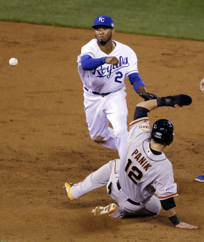 San Francisco Giants' Joe Panik (12) is out at second as Kansas City Royals' Alcides Escobar turns a double play on a ball hit by Buster Posey during the third inning of Game 6 of baseball's World ...