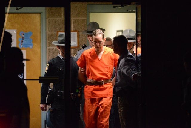 State troopers escort Eric Matthew Frein from the Blooming Grove barracks early Friday Oct. 31, 2014. Frein, accused of opening fire on the barracks Sept. 12, killing state police Cpl. Bryon K. Di ...
