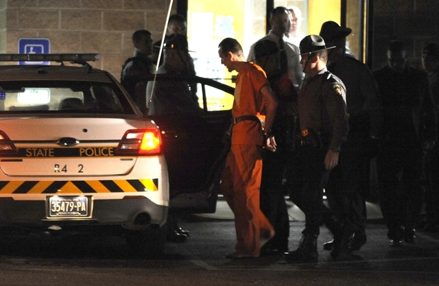 Erin Frein, suspected of shooting two Pennsylvania state troopers last month, is led from the state police barracks in Blooming Grove, Pa. on Friday, Oct. 31, 2014. Frein was arrested Thursday nig ...