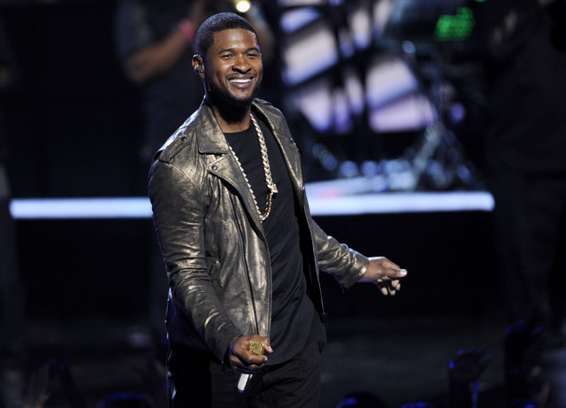 FILE - In this June 29, 2014 file photo, Usher performs at the BET Awards at the Nokia Theatre in Los Angeles. Usher launches his UR Experience World Tour in Montreal on Saturday, Nov. 1. (Photo b ...