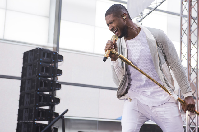 """FILE - In this Sept. 5, 2014 file photo, Usher performs on NBC's """"Today"""" show in New York. Usher launches his UR Experience World Tour in Montreal on Saturday, Nov. 1. (Photo by Charles  ..."""