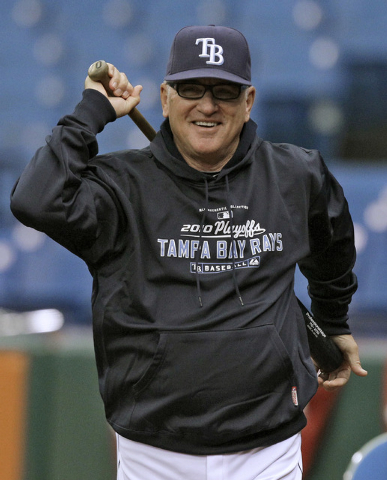 In this Oct. 5, 2010, file photo, Tampa Bay Rays manager Joe Maddon smiles as he looks on during baseball practice in St. Petersburg, Fla. The Cubs have fired manager Rick Renteria after one seaso ...