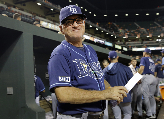 In this Aug. 27, 2014, file photo, Tampa Bay Rays manager Joe Maddon smiles at a fan in the stands in the fifth inning of a baseball game against the Baltimore Orioles in Baltimore. The Cubs have  ...