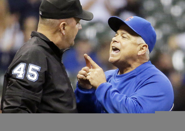 FILE - In this Sept. 26, 2014, file photo, Chicago Cubs manager Rick Renteria, right, argues with umpire Jeff Nelson during the eighth inning of a baseball game against the Milwaukee Brewers, in M ...