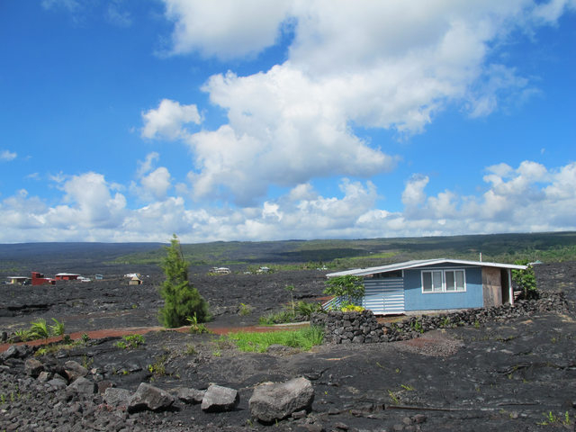 A house sits among recent lava flow in Kalapana, Hawaii on Thursday, Oct. 30, 2014. Ten miles from Pahoa, the small Hawaii town held hostage by a slowly oozing stream of lava from Kilauea volcano, ...