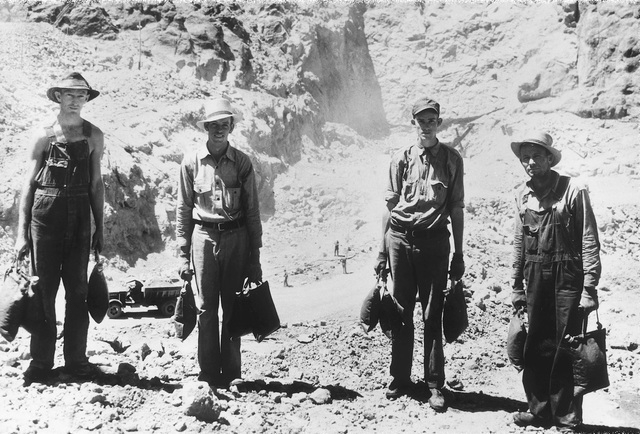 Workman at isolated points around the Hoover Dam project away from drinking fountains were supplied by desert water bags carried by water boys July 14, 1932. (File)