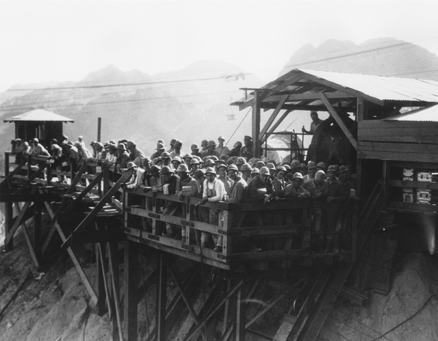 "Workers preparing to ride the ""monkey slide"" down into the canyon 1932. (File)"