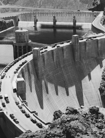 Bridging the Colorado River between Nevada and Arizona, Hoover Dam provides a two-lane highway for the 108,528 tourists who visited the dam in 29,182 cars and 216 buses during August 1939. One hun ...