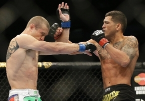 Lightweight Anthony Pettis, right, trades blows with Donald Cerrone on Saturday during UFC on Fox 6 at Chicago. Pettis knocked out Cerrone with a liver kick in the first round.