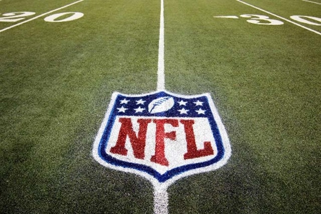 In this Nov. 20, 2011, file photo, an NFL logo is displayed on the Ford Field turf before an NFL football game. (AP Photo/Carlos Osorio, File)
