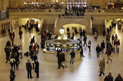 Pedestrians and travelers stroll through the main concourse of Grand Central Terminal in New York. The landmark, one of the country's finest examples of Beaux Arts architecture and the most famous ...