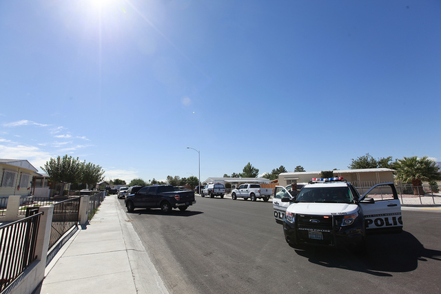 Las Vegas police and SWAT are on scene of a barricade situation at a home near Torrey Pines Drive at Alexander Road. (Chase Stevens/Las Vegas Review-Journal)
