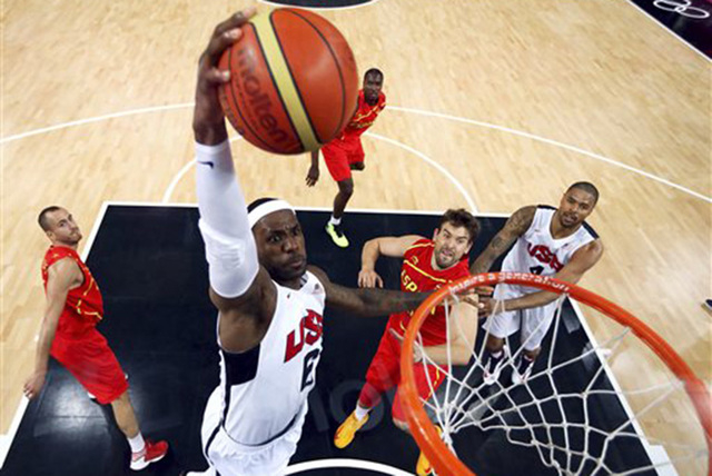 In this Aug. 12, 2012, file photo, United States' LeBron James (6) dunks against Spain during the men's gold medal basketball game at the 2012 Summer Olympics in London. James said Monday, Sept. 2 ...