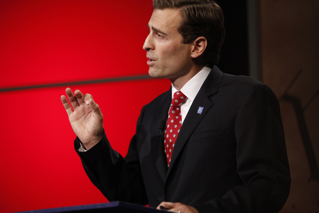 Adam Laxalt, Republican candidate for Nevada attorney general, speaks during a debate against his opponent, Ross Miller, at Vegas PBS in Las Vegas, Oct. 10, 2014. Lawyers for Laxalt have asked Nev ...