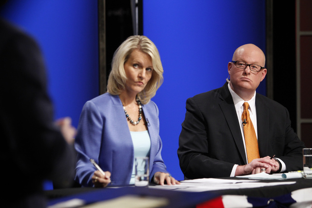 Debate moderators Elizabeth Thompson, left, and Steve Sebelius, Las Vegas Review-Journal columnist, listen to Nevada attorney general candidate Ross Miller during his debate against his opponent A ...