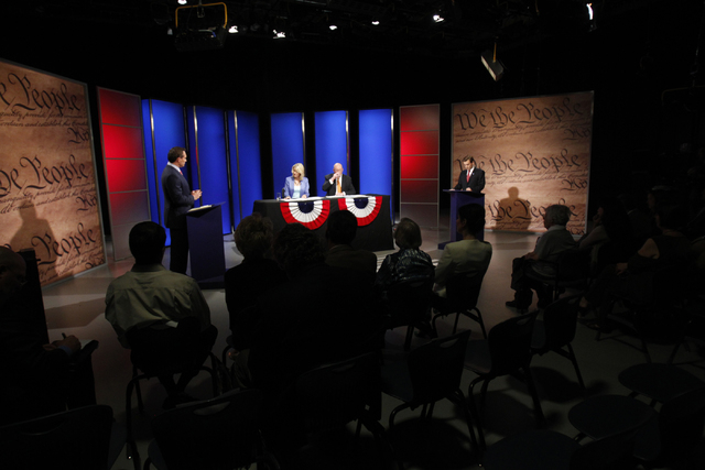 Nevada attorney general candidate Ross Miller, left, participates during a debate against his opponent, Adam Laxalt, right, at Vegas PBS in Las Vegas Friday, Oct. 10, 2014. The candidates discusse ...