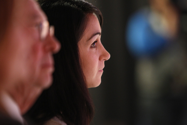 Jaime Laxalt watches her husband, Adam, Nevada attorney general candidate, during his debate against his opponent, Ross Miller, at Vegas PBS in Las Vegas Friday, Oct. 10, 2014. The candidates disc ...