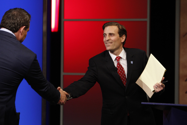 Nevada attorney general candidate Ross Miller hand shakes with his opponent, Adam Laxalt, following their debate at Vegas PBS in Las Vegas Friday, Oct. 10, 2014. The candidates discussed issues th ...