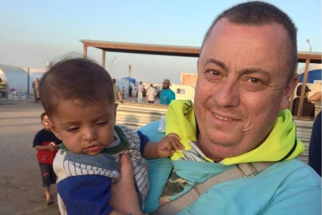 British aid worker Alan Henning is shown in an undated photo taken at a refugee camp on the Turkish-Syria border. Islamic State militants fighting in Iraq and Syria released a video on Friday, Oct ...