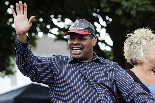 In this June 12, 2011, file photo, former heavyweight boxing champion Leon Spinks waves during a Boxing Hall of Fame parade in Canastota, N.Y. Leon Spinks is in a Las Vegas hospital after a second ...
