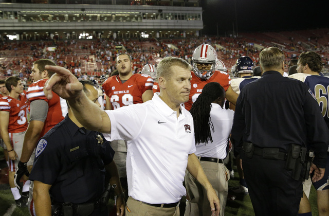 UNLV head coach Bobby Hauck hasn't had much to celebrate this season. He didn't crack a smile after defeating Northern Colorado on Sept. 6, 2014 at Sam Boyd Stadium. (AP Photo/John Locher)