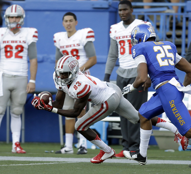 UNLV's Devonte Boyd (83) makes a reception past San Jose State's Akeem King (25) during the first half of an NCAA college football game Saturday, Oct. 4, 2014, in San Jose, Calif. (AP Photo/Ben Ma ...