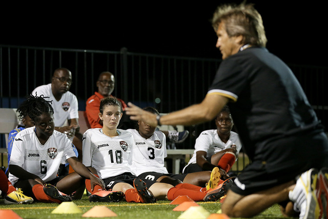 Trinidad & Tobago women's national soccer team head coach Randy Waldrum, right, instructs Khadidra DeBessette (6), Anique Walker (18), Mariah Shade (3) and the rest of the team at half time of an  ...