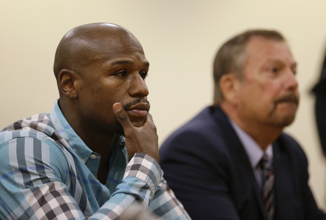 Floyd Mayweather, left, appears with attorney Shane Emerick before the Nevada Athletic Commission Tuesday, Sept. 23, 2014, in Las Vegas. Mayweather appeared before the commission to answer questio ...