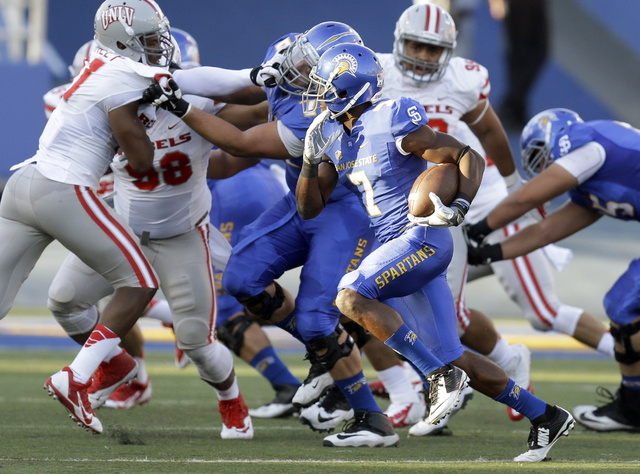 San Jose State's Tyler Ervin (7) runs against UNLV during the first half of an NCAA college football game Saturday, Oct. 4, 2014, in San Jose, Calif. (AP Photo/Ben Margot)