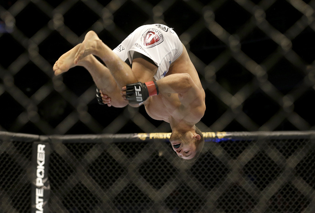 Chad Mendes back flips while celebrating after beating Darren Elkins during the first round of a UFC featherweight mixed martial arts fight in San Jose, Calif., Saturday, April 20, 2013. Mendes wo ...