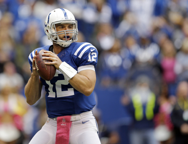 Indianapolis Colts quarterback Andrew Luck throws against the Baltimore Ravens during the first half of an NFL football game in Indianapolis, Sunday, Oct. 5, 2014. (AP Photo/Jeff Roberson)