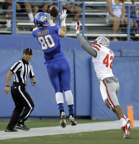 San Jose State's Andrew Vollert (80) makes a reception against UNLV's Peni Vea (42)  during the first half of an NCAA college football game Saturday, Oct. 4, 2014, in San Jose, Calif. (AP Photo/Be ...
