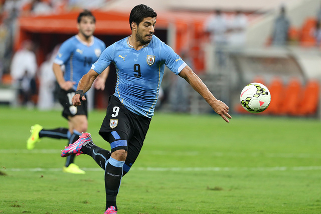 Uruguay's Luis Suarez, runs for the ball during the international friendly soccer match between Saudi Arabia and Uruguay at King Abdullah stadium in Jiddah, Saudi Arabia, Friday, Oct. 10, 2014. (A ...