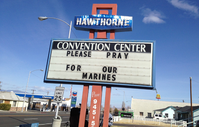 A sign showing support Tuesday March 19, 2013 for the seven U.S. Marines killed in an explosion March 18, 2013. The explosion also injured a half-dozen more during a training exercise in the Nevad ...