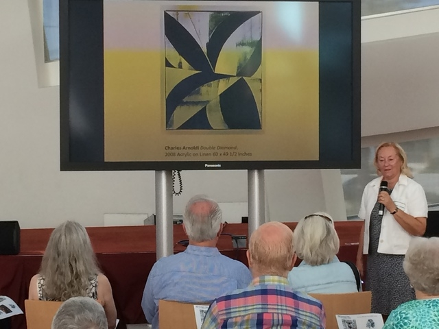 """Suzanne Kaplan, a five-year volunteer docent, leads a discussion about the Charles Arnoldi painting """"Double Diamond."""" (Linda Simpson/Special to View)"""