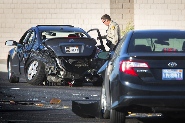 Las Vegas Police investigate a multiple auto accident on Buffalo Road near Rochelle Street on Monday, Oct. 13, 2014.  (Jeff Scheid/Las Vegas Review-Journal)