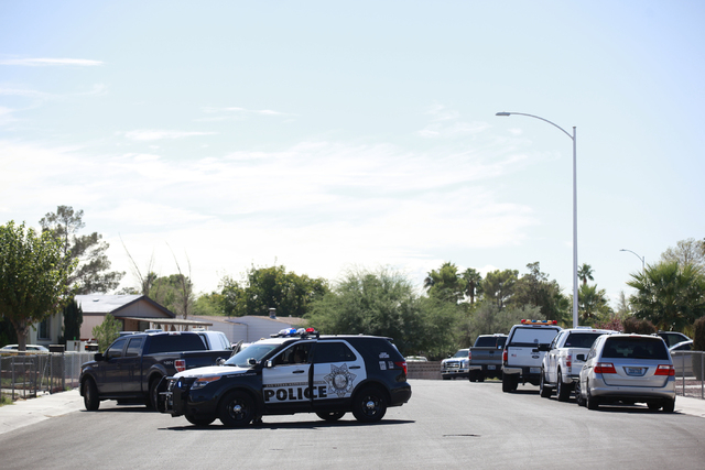 Las Vegas police and SWAT respond to a barricade situation at the 6400 block of Bamboo Place as seen from Jasper Avenue and Hartman Street in Las Vegas on Wednesday, Oct. 8, 2014. A man who appear ...
