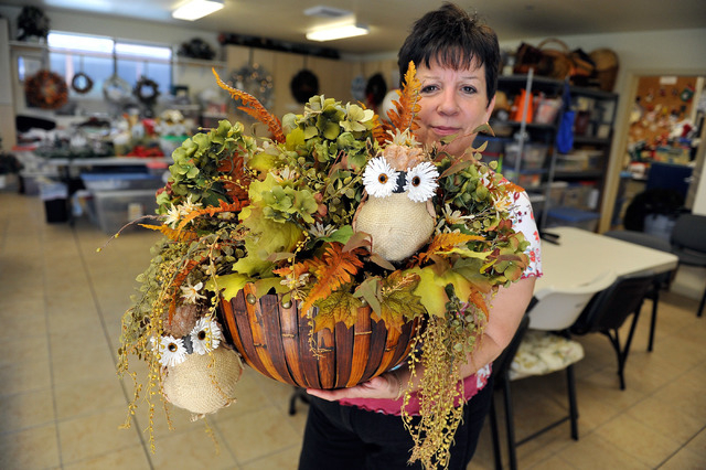 Elise Rigatuso displays an autumn arrangement that will be for sale at the 40th annual Holiday Boutique at the Children's Service Guild workshop at Child Haven in Las Vegas on Friday, Sept. 26, 20 ...